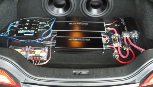Generating a Decision Between Vehicle Audio Amplifiers